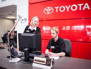 Young man and woman at Toyota reception desk