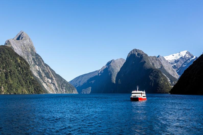 A tourist boat sails through Doubtful Sound, New Zealand