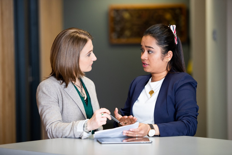 A career consultant speaks with a client