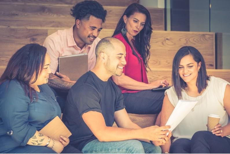 Workers meet informally to go over plan