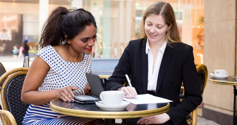 Two women having a business meeting over coffee