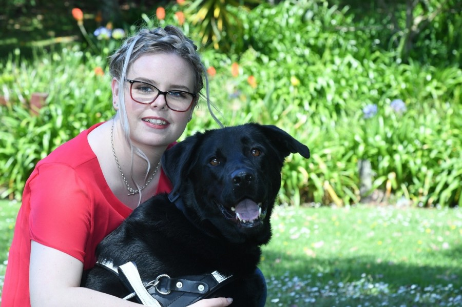 Stevi with her guide dog Halo