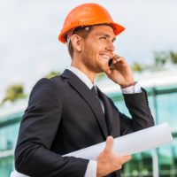 Man in hard hat holds construction plans
