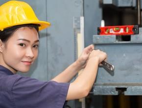Woman tightening nut on fixed beam