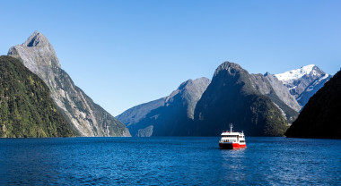 A tourist boat sails through Doubtful Sound, New Zealand