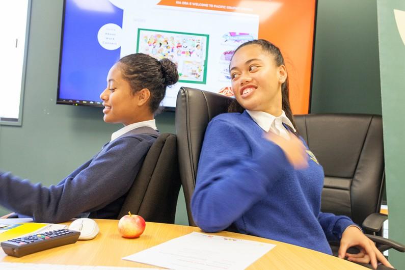 Two Pasifika students at a desk