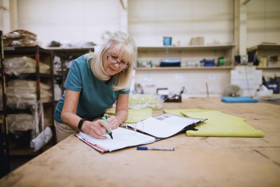 A mature worker checks details in a folder