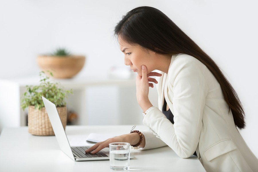 A woman does a test at a laptop