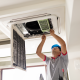 man repairs air conditioner
