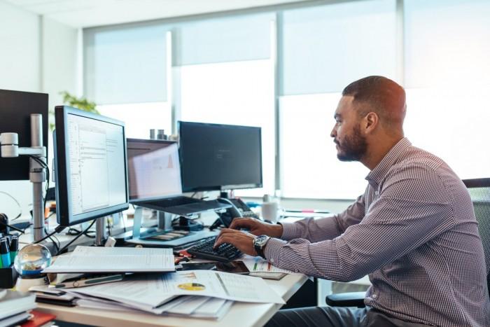 A man types on a computer