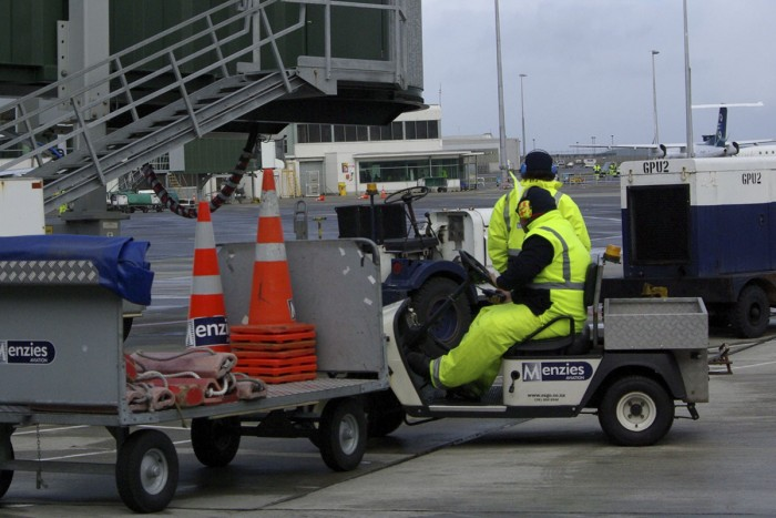 Aircraft loaders working on the tarmac at Wellington Airport