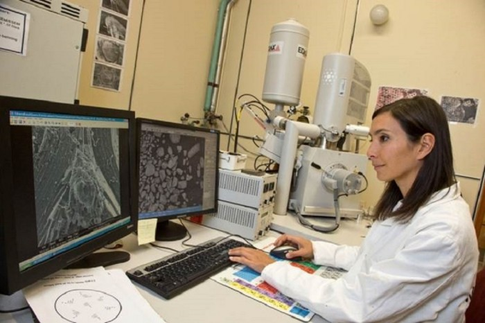 Nanotechnologist Michelle Dickinson sits at a computer in a medical laboratory