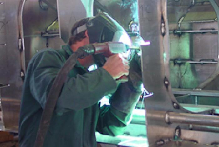 Sam Christiansen working on he internal framing of an aluminium boat