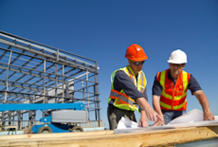 A building and construction manager looking at plans with a building contractor