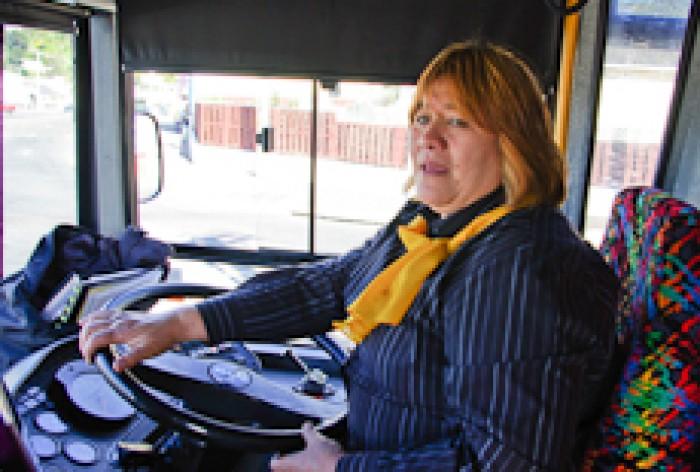 Patz Powhare steering her bus