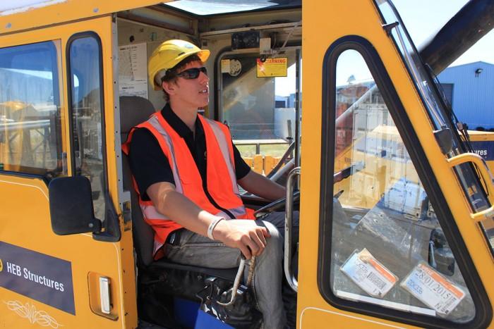 A man operating a crane