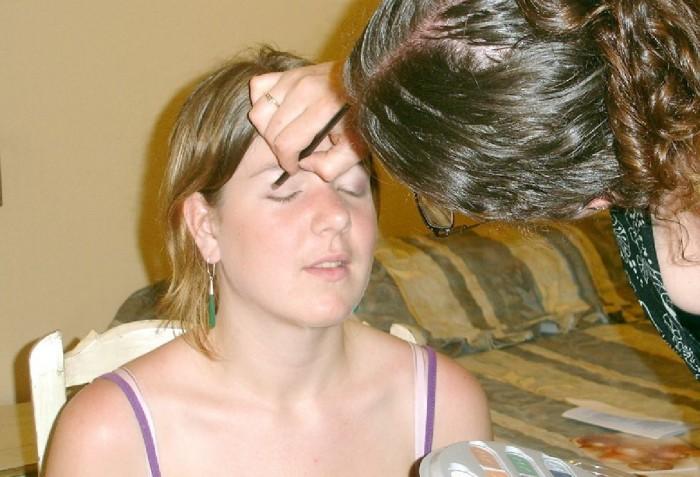 Kimberly Romeril putting make-up on a woman