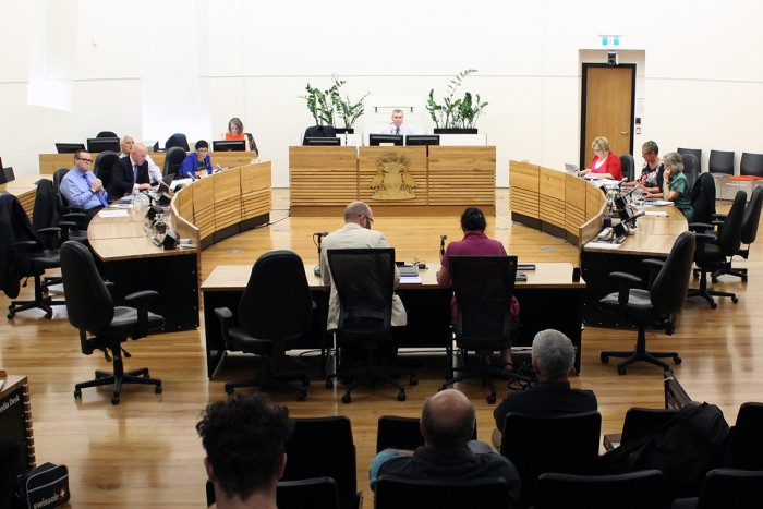 Group of people take part in a select committee meeting