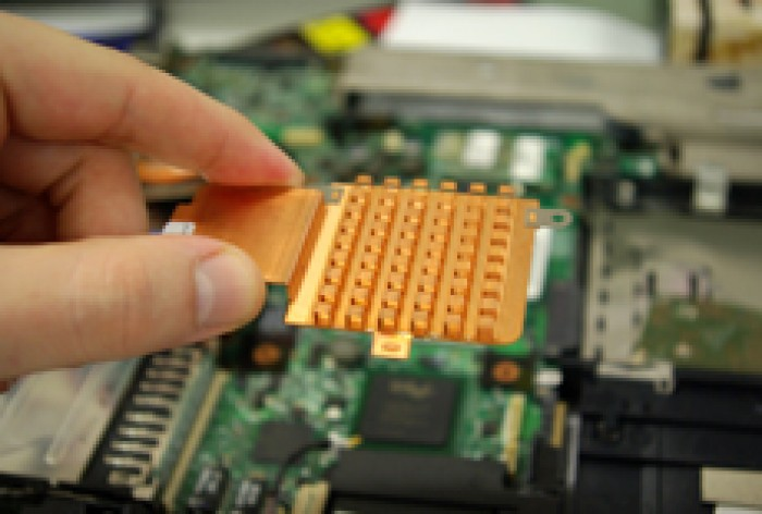 A hand holding part of a circuitboard
