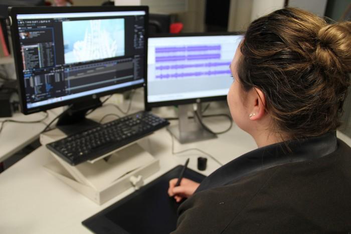 Eleanor Beeden editing a corporate video