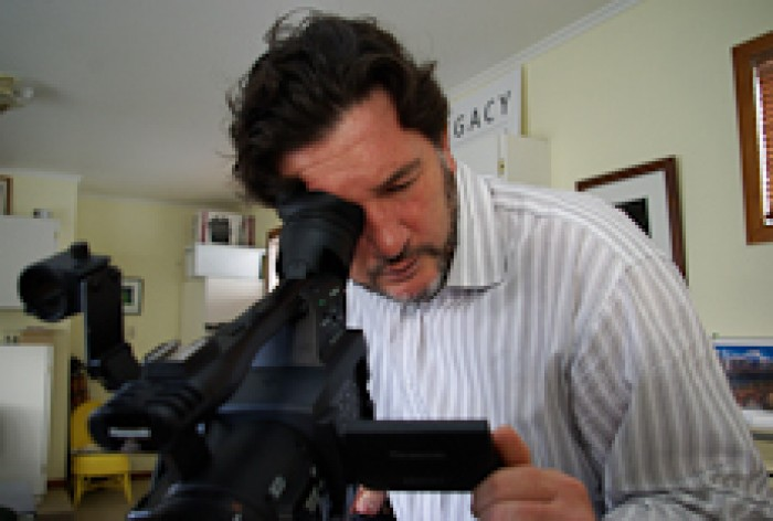 Mark Walsh lining up a shot with a video camera
