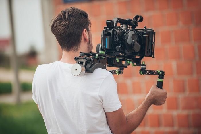 Camera operator filming a scene