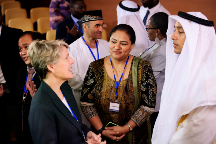 Foreign policy officers talking with Arab diplomats