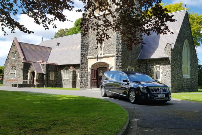 A hearse outside a church