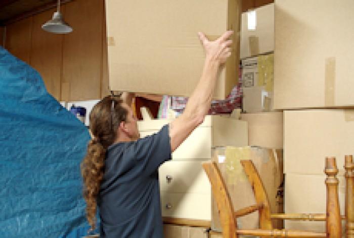 Dean Jenson moving boxes.