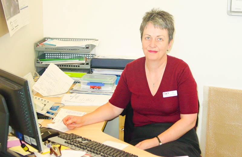 Trisha Dunn Writing At A Desk. Health Services ...