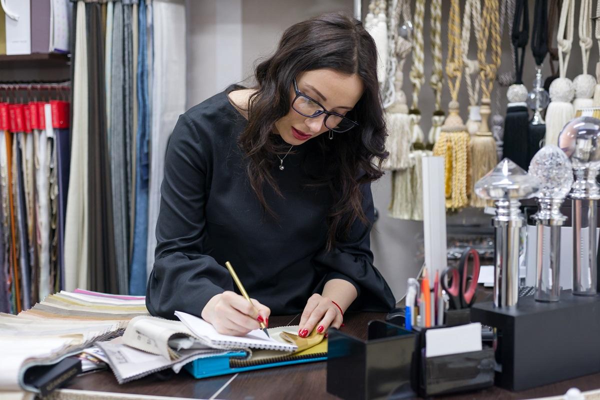 An interior designer checks fabrics in a curtain shop