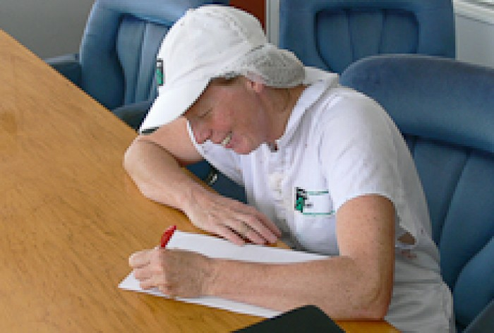 Kay Burt writing at a desk