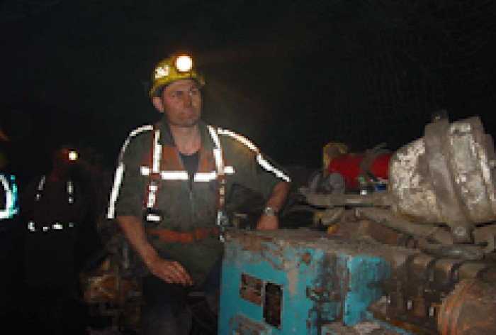 Brian Wishart standing in a mine