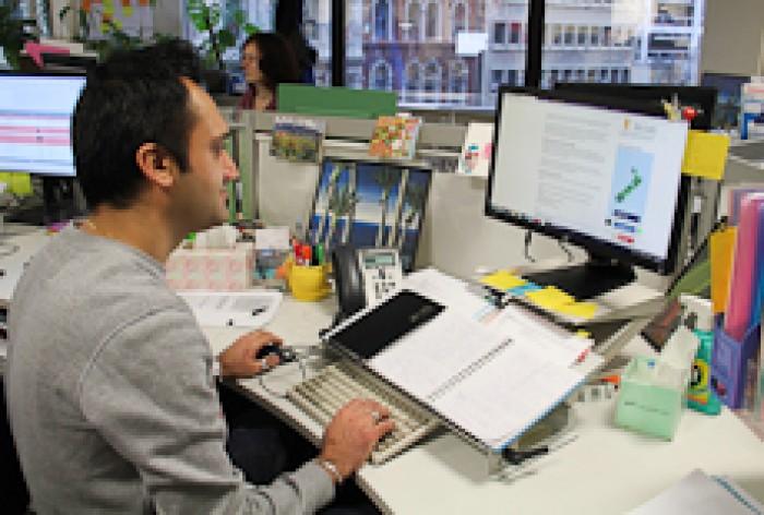 Anish Nandha sitting at a computer