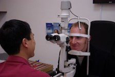Selwyn Yan tests a customer's eyes.
