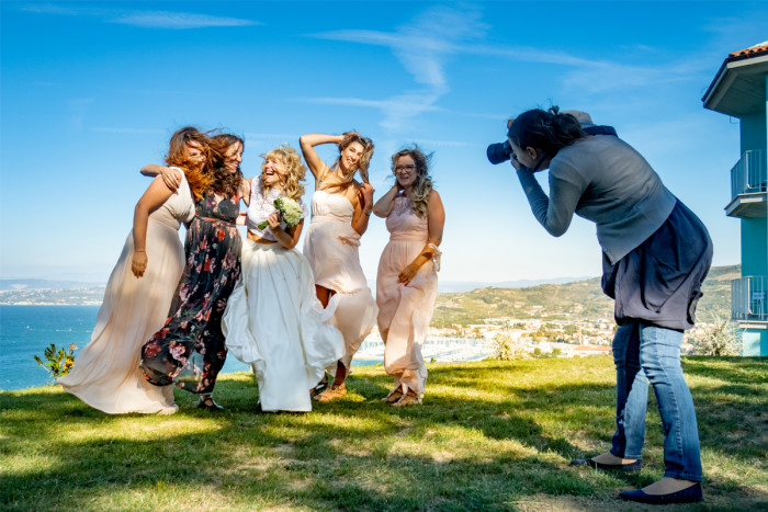 Photographer taking a photo of a wedding group