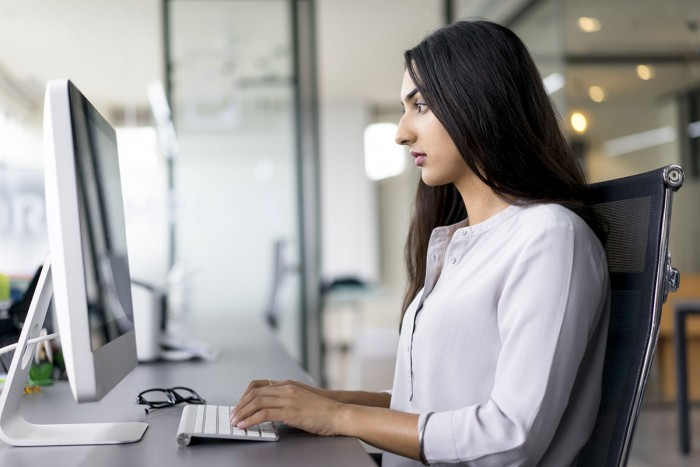 Woman works at a computer
