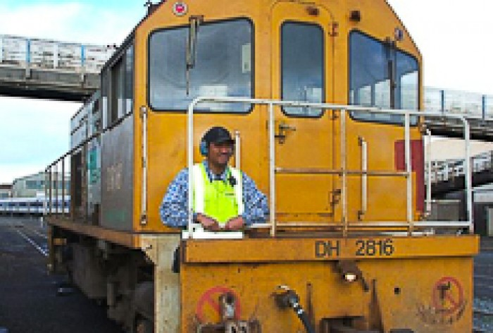 Eddie Tugaga standing at the front of a locomotive
