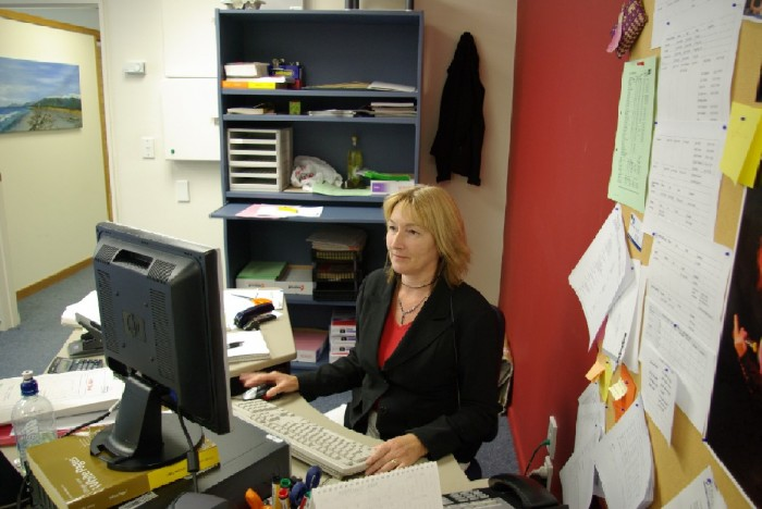 Sheila Sharpe working at the computer