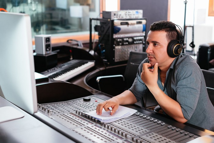 Sound technician working at a mixing desk