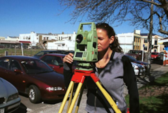 Rebekha Upston uses a surveying instrument to take measurements