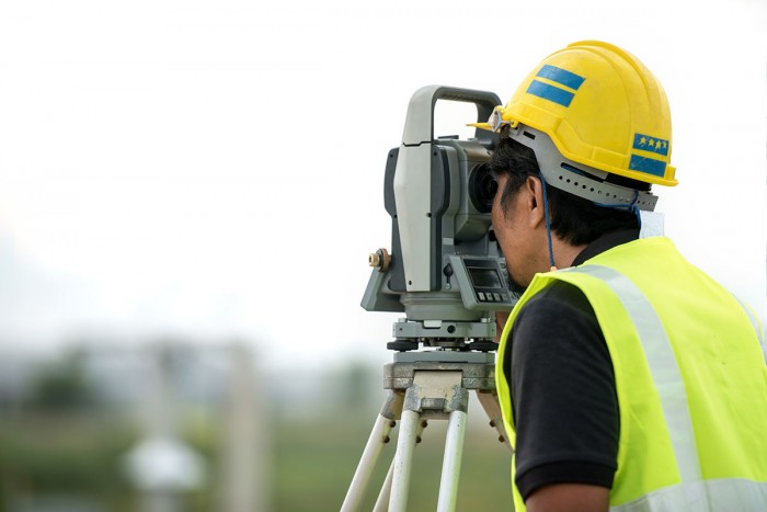 Man using a total station