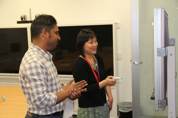 Xianglin Deng and Lakshmi Toleti discuss some plans for a telecommunications project