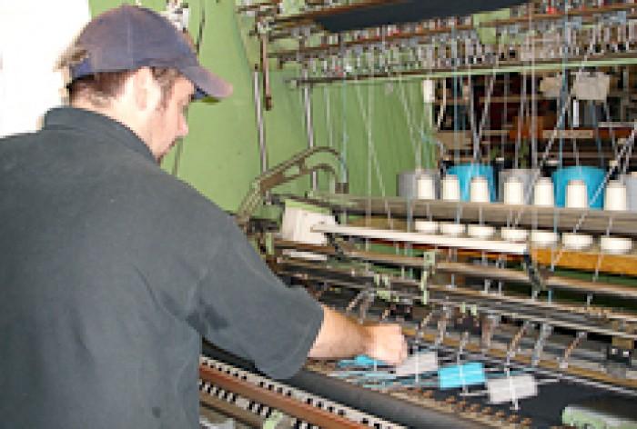 Glen Signal adjusting a textile machine