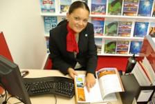 Jessica Strawbridge points to a destination in a travel brochure