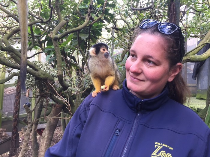 Harmony Neale with a squirrel monkey on her shoulder