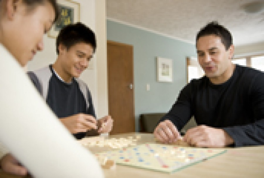 A family group playing scrabble.