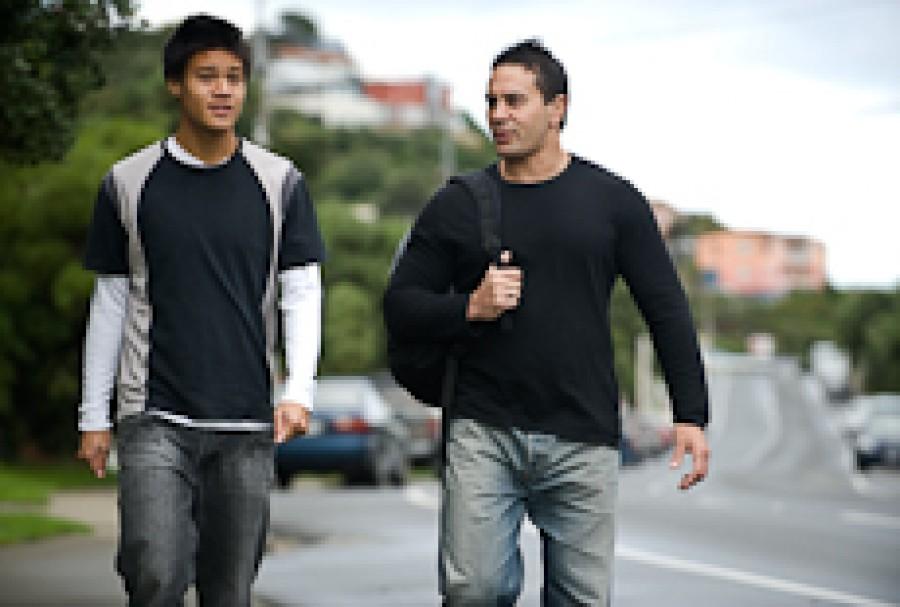 Two men walking down the street