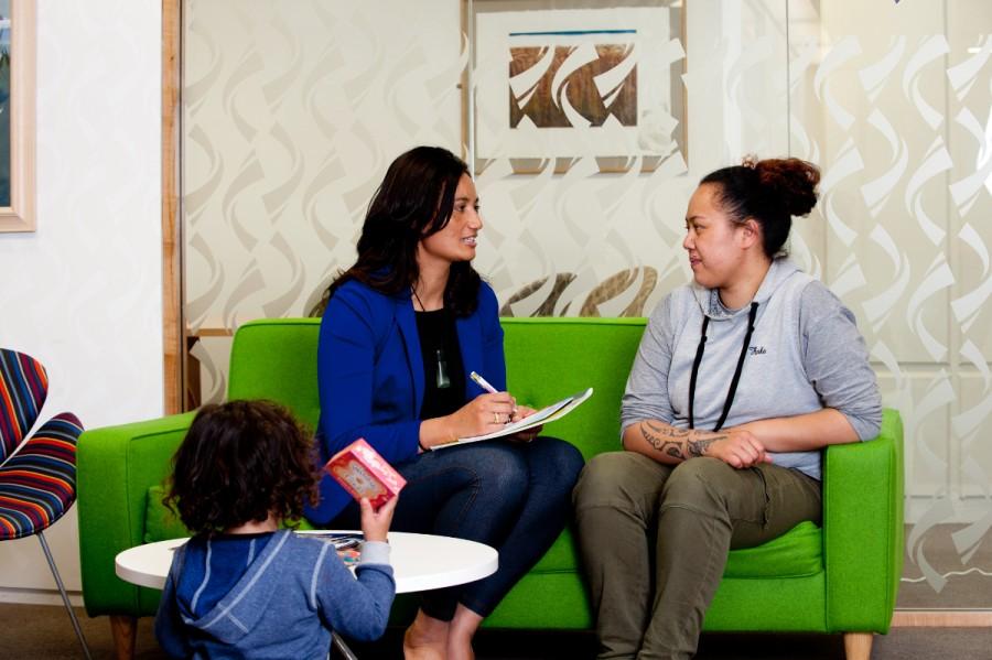 A teacher consults with a Maori parent