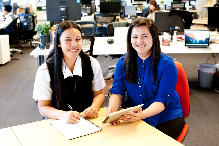 Two Maori students study at a desk